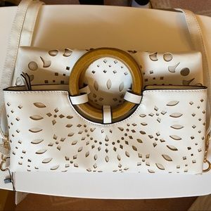 Laser cutout bag with wooden handle